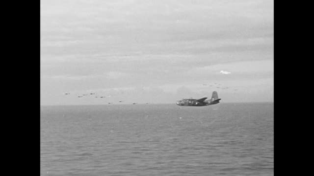 tiltaround shot 6 b26 marauder airplanes pass fly over / vs bombers in formation fly low over ocean / pov from camera plane of bomber in flight /... - bomber stock videos and b-roll footage