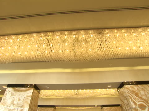 tiltdown from a crystal chandelier to the interior of the lobby of the intercontinental hotel - intercontinental hotels group stock videos & royalty-free footage