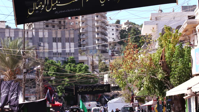 tiltdown from an ashura banner to the street below after the commemoration processions ashura is the 10th day of muharram commemorating the martyrdom... - ashura muharram stock videos & royalty-free footage