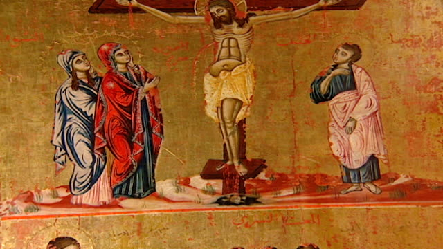 stockvideo's en b-roll-footage met tilt-down from the crucifixion to the last supper from an icon in the saint sergius and saint bacchus church. the church suffered extreme damage... - apostel