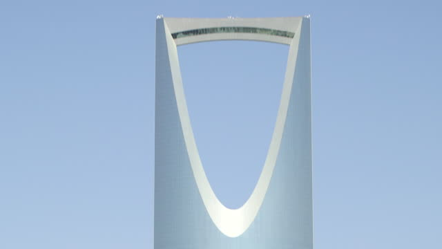 tilt-down from the distinctive parabolic arch of the kindgom centre in riyadh. - riyadh stock videos & royalty-free footage