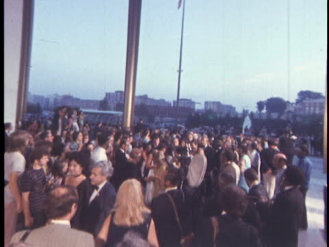 tiltdown of guests enjoying themselves and conversing with others at the opening of the john f kennedycenterfor performing arts on september 8 1971... - john f. kennedy center for the performing arts stock videos & royalty-free footage