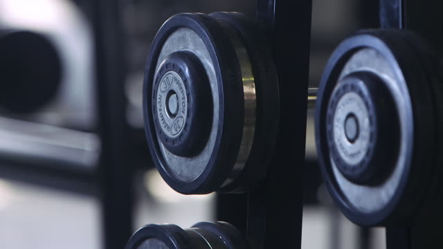 tilt-down of gym weights. - weight stock videos & royalty-free footage
