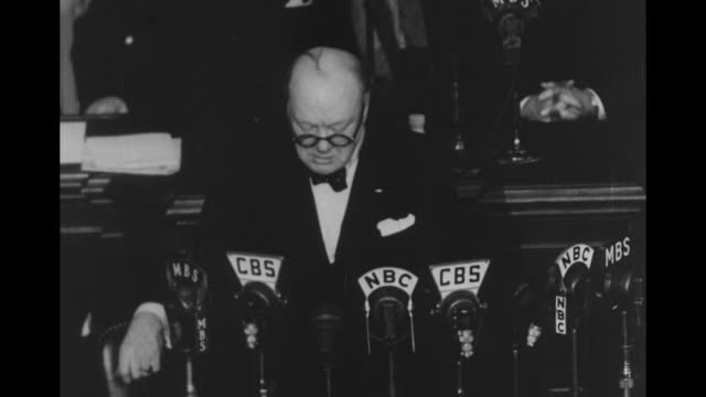 ws tiltdown rear shot standing ovation from joint session of congress during winston churchill's appearance there ovation ends audience sits / cu... - paramount building stock videos and b-roll footage