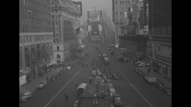 tiltdown shot deserted manhattan street with cars taxis trucks parked at curb / civil defense workers and nypd officer on street in front of childs... - manhattan theater district stock videos and b-roll footage