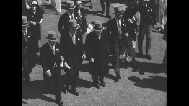 Tiltdown shot former British Prime Minister Winston Churchill walks on grounds of Ascot Racecourse as he arrives for the Ascot Gold Cup he walks with...