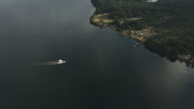 Tilt-down shot of a ferry sailing toward Anderson Island Ferry Terminal