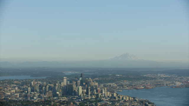 Tilt-down shot of Downtown Seattle with Queen Anne in the foreground