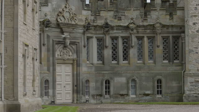 tilt-down shot of the facade of floors castle - stone object stock videos & royalty-free footage