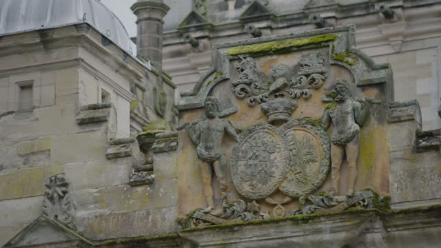 tilt-down shot of the roxburghe family crest on the facade of floors castle - stone object stock videos & royalty-free footage