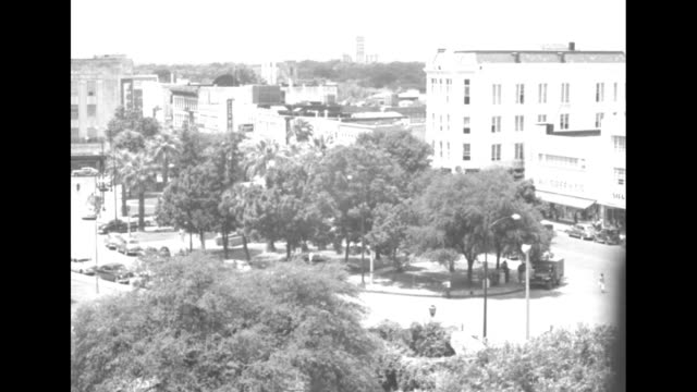 """tilt-down shot park and downtown area of san antonio, tx, with a """"walgreen co."""" visible at right / a car passes ruins of a stone church with a spire... - spire stock videos & royalty-free footage"""