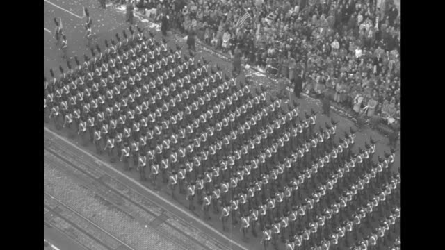 tiltdown shots of united states military marching during president dwight eisenhower's inaugural parade / washington police chief robert v murray... - präsidenten amtseinführung stock-videos und b-roll-filmmaterial