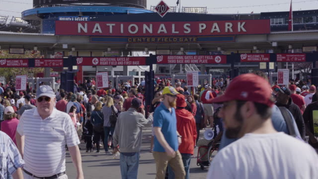 tilt-down to fans entering nationals park - nationals park stock videos & royalty-free footage