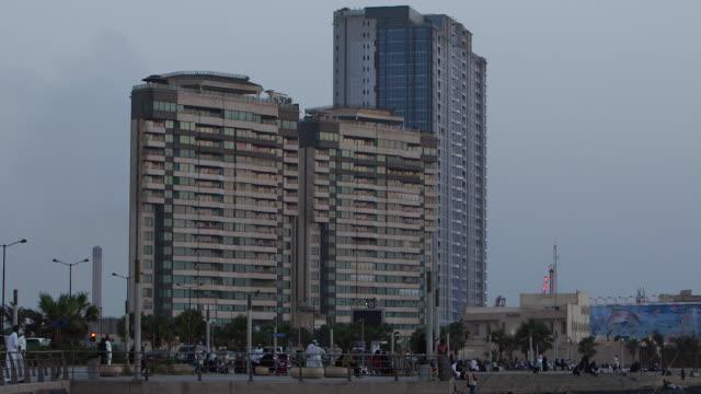 tiltdown to fishermen on jeddah corniche - red sea stock videos & royalty-free footage