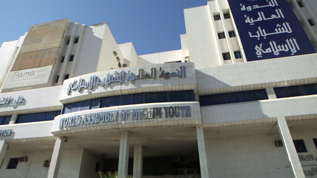 tilt-down to the world assembly of muslim youth building in riyadh. wamy is reportedly the largest muslim organisation in the world. - youth organisation stock videos & royalty-free footage