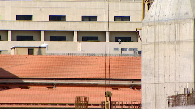 tiltdown with a crane line and hook to workers standing on scaffolding on the construction site of the mohammad alamin mosque in downtown beirut aka... - blue mosque stock videos & royalty-free footage