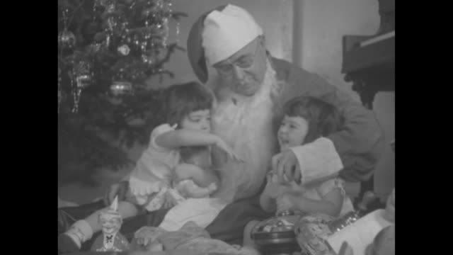 "merry christmas"" / title ""pathe's babies, the dionne quintuplets"" superimposed over decorated christmas tree / shot of exterior of home of... - ontario canada stock videos & royalty-free footage"