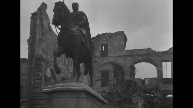 stockvideo's en b-roll-footage met tilted views of smoldering ruins and skeletons of ruined buildings with arched stone bridge / vs expansive view of smoking rubble / equestrian... - geruïneerd