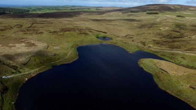 tilting aerial drone of natural irish peninsula - peninsula stock videos and b-roll footage