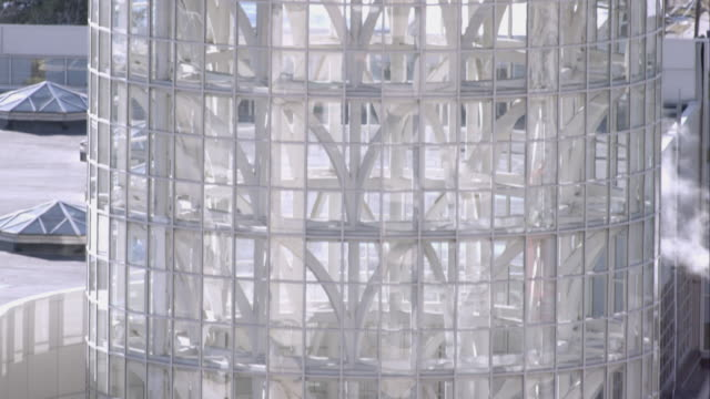 tilting down shot of the salt palace convention center in salt lake city, utah. - curtain wall facade stock videos and b-roll footage