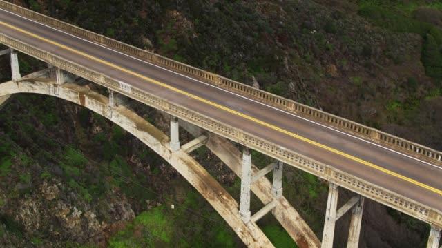 tilting drone shot of bixby creek bridge, big sur - bixby creek bridge stock videos & royalty-free footage