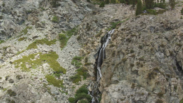 tilting drone shot of waterfall in california sierra nevada - wilderness area stock videos & royalty-free footage