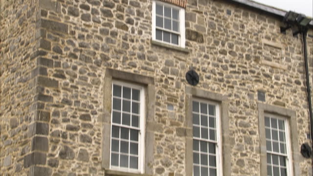 tilting shot of an old stone house - stone house stock videos & royalty-free footage
