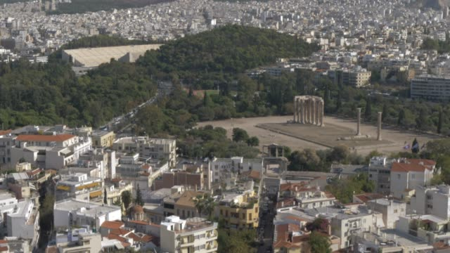 Tilting shot of Panathenaic Stadium and Temple of Olympian Zeus from the Acropolis, Athens, Greece, Europe