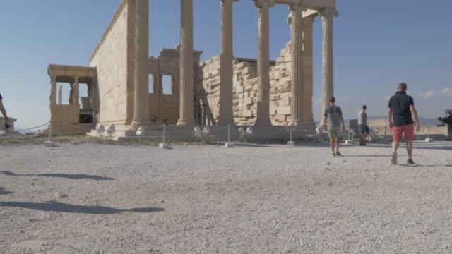tilting shot showing the erechtheion, the acropolis, unesco world heritage site, athens, greece, europe - the erechtheion stock videos & royalty-free footage
