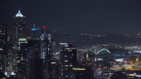 tilting up, aerial view of the seattle skyline at night - american interstate stock videos & royalty-free footage