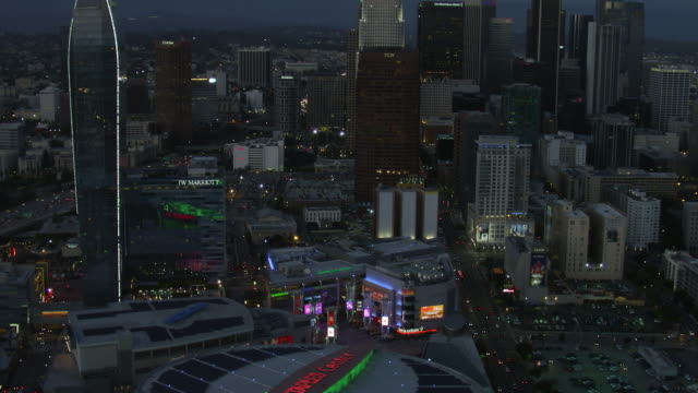 tilting up from staples center to view of downtown skyscrapers in los angeles. - staples center stock videos & royalty-free footage