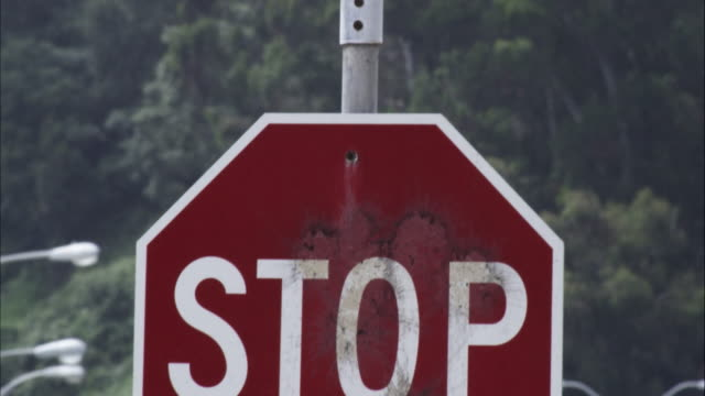 tilting up shot of a stop sign to a street sign. california ave. - 道路名の標識点の映像素材/bロール
