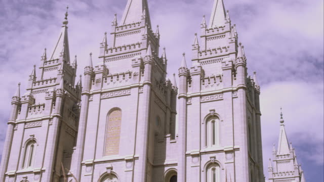 tilting up shot of the front of the lds salt lake temple from a diagonal angle. - mormonism stock videos & royalty-free footage