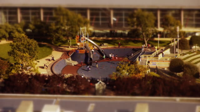 tilt-shift miniature effect shot of playground in soma district, san francisco - spoonfilm stock-videos und b-roll-filmmaterial