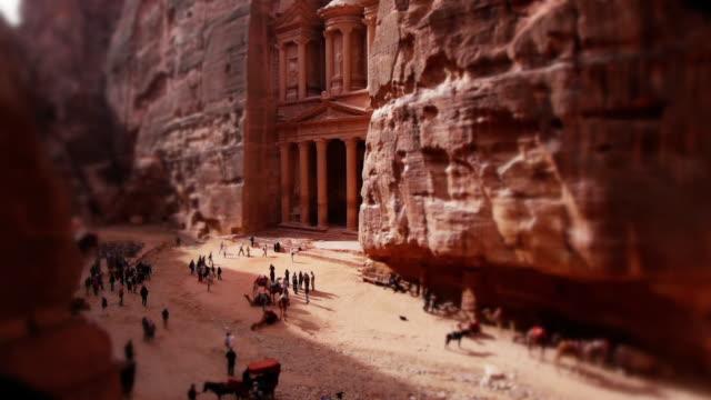 tilt-shift miniature effect shot of the treasury in petra, jordan. - old ruin stock videos & royalty-free footage