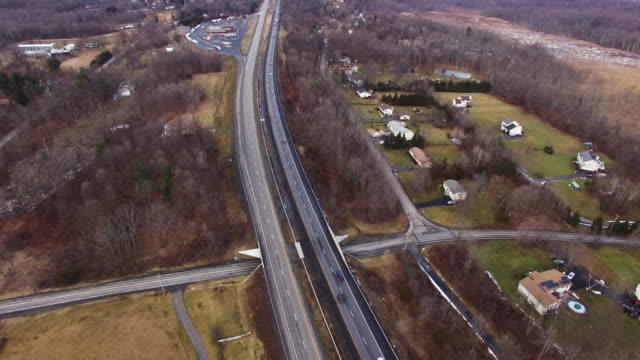 tilt-up aerial from upstate new york highways to catskill mountain range - hudson valley stock videos and b-roll footage
