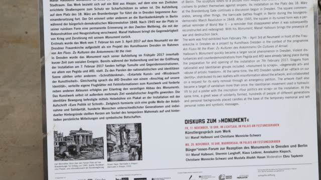 Tiltup and closeup of an information about the installation GermanSyrian artist Manaf Halbouni attends the installation of his work 'Monument' in...