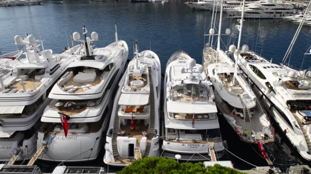 tilt-up from superyachts,yacht harbour,port hercule,la condamine - monaco stock videos and b-roll footage