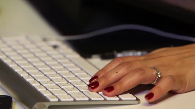 tilt-up of a woman's with her fingers on a computer keyboard while using a digital graphic tablet and pen. - working stock videos & royalty-free footage