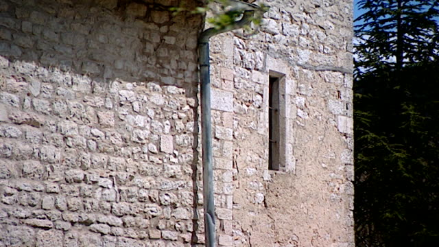 tilt-up of the bell tower of the medieval church of saint maron in volperino. during the crusades the relics of saint maron, founder of the maronite... - the crusades stock videos & royalty-free footage
