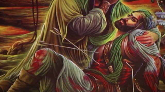 tilt-up on a painting depicting the death of hussain ibn ali at the battle of kerbala. this type of painting is used in the ashura commemorations. - ashura muharram stock videos & royalty-free footage