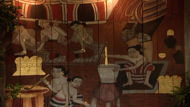 tiltup over a painted wooden panel hanging on a veranda depicting traditional thai women cooking - veranda stock videos & royalty-free footage