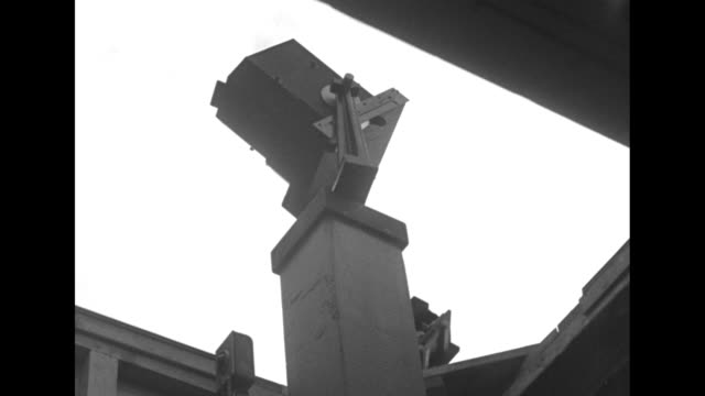 tilt-up shot dr. p. m. millman checking meteor spectrum cameras at harvard college observatory observation station / camera / note exact day not known - astronomy stock videos & royalty-free footage