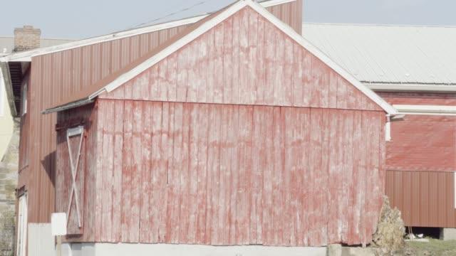 tilt-up shot of a red farmhouse - pennsylvania stock videos & royalty-free footage