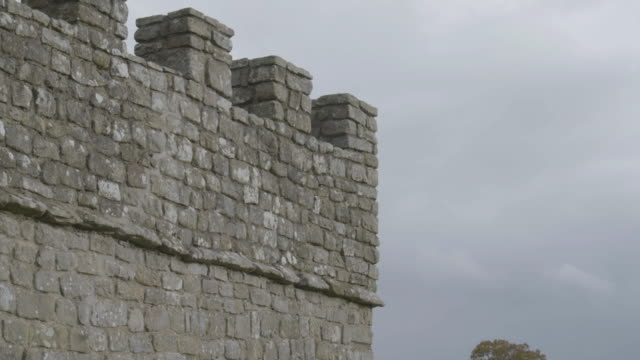 tilt-up shot of a watchtower at the vindolanda roman fort - archaeology stock videos & royalty-free footage