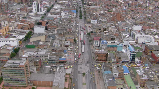 tilt-up shot of bogota cityscape with mountains in background, colombia - bogota stock videos & royalty-free footage