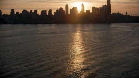 tilt-up shot of downtown seattle at sunrise - elliott bay stock videos & royalty-free footage