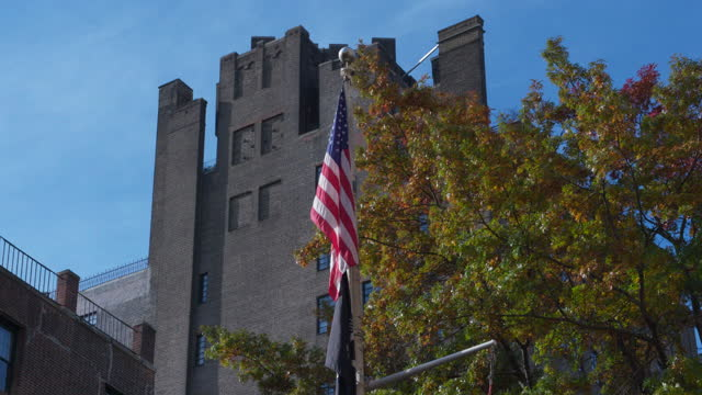 tilt-up shot of flags flying next to the stonewall national monument in greenwich village - 1969 stock videos & royalty-free footage