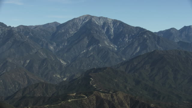 tilt-up shot of mount baldy peak in san gabriel mountains - wilderness stock videos and b-roll footage