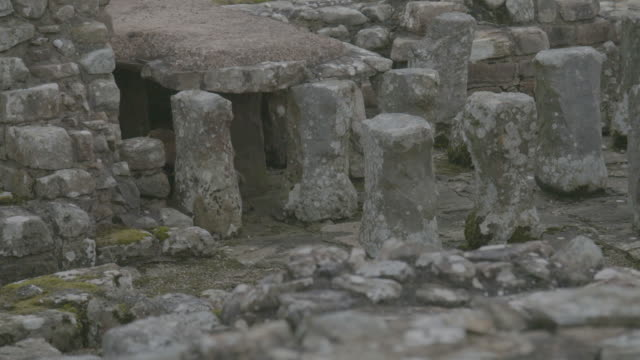 tilt-up shot of pilae stacks of the hypocaust system in a military bath house at the vindolanda roman fort - column stock videos & royalty-free footage